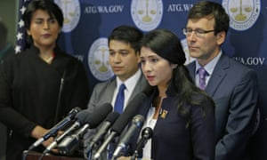 Faride Cuevas, second from right, a Dreamer, talks to reporters in Seattle, as the Washington attorney general, Bob Ferguson, right, and two other DACA participants look on.