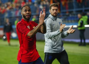 Raheem Sterling applauds England's travelling fans.