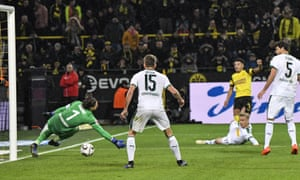Jadon Sancho beats Gladbach keeper Yann Sommer from a tight angle to give Dortmund the lead.