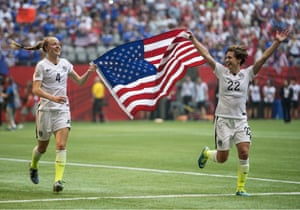 The flags are out, as USA teammates Becky Sauerbrunn, left, and Meghan Klingenberg celebrate becoming world champions.