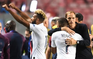 Paris Saint-Germain's German coach Thomas Tuchel celebrates with Mbappe after their win.