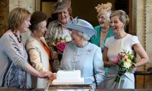 The Countess of Wessex (right) and Princess Anne (second left) watch as the Queen cuts a cake at the WI's centenary annual meeting.