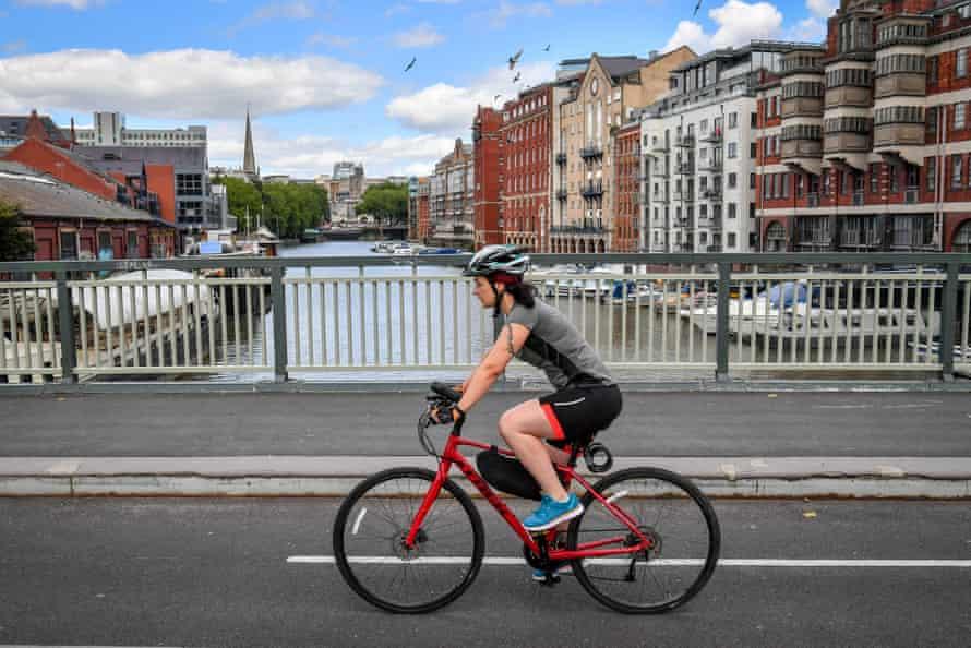 A cyclist crosses a bridge in Bristol.