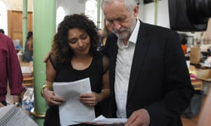 Labour leader Jeremy Corbyn comforts a relative of Jessica Urbano who has been missing since the fire.
