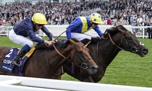 James Doyle riding Poets Word, right, gets up to win.