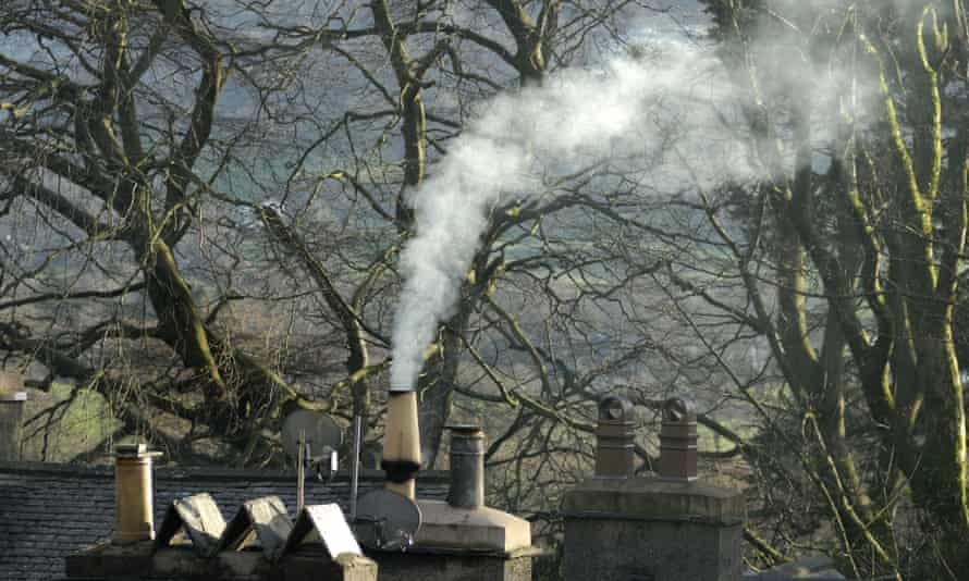 Smoke rises from a chimney in Coniston in the Lake District, England.