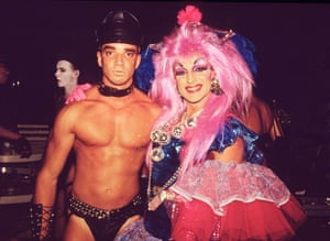 A photograph of two revellers at a queer party