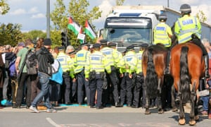 Police take action as protesters attempt to stop traffic entering DSEI on 9 September 2017.