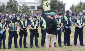 Far-right and anti-racism demonstrators rally at Melbourne's St Kilda beach