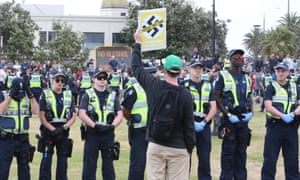 A line of police officers keeping watch over demonstrators during a far right rally on St Kilda foreshore in Melbourne, Victoria, Australia, 05 January 2019.
