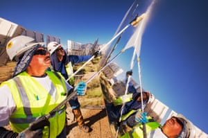 Workers washing the heliostats to maximise reflective power at the Ivanpah solar thermal power plant