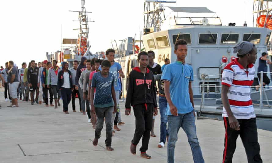 African migrants arrive at the naval base in Tripoli, the Libyan capital