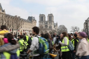 'Yellow vest' protesters march past the Notre Dame during an anti-government demonstration in March 2019