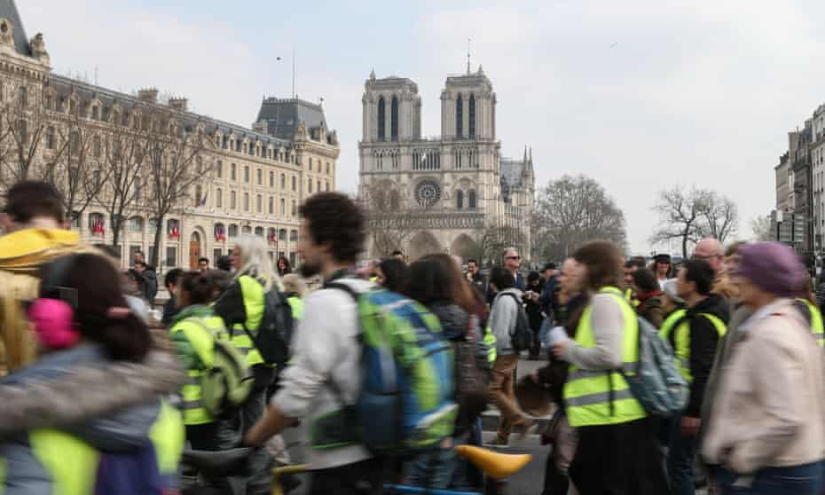 Protesters march past Notre Dame Cathedral on 23 March.