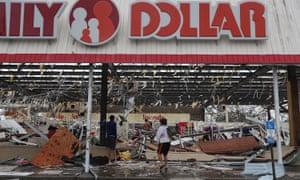 People look on at a damaged store after Hurricane Michael passed through on October 10, 2018 in Panama City, Florida. Michael made landfall at Mexico Beach today a Category 4 storm, with maximum sustained winds of 155 mph, the most powerful storm ever to hit the Florida Panhandle. (Photo by Mark Wallheiser/Getty Images)