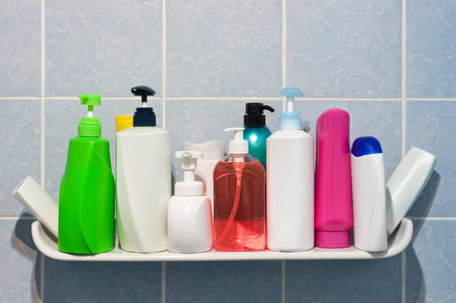 Several bottles of shower gel, shampoo and other washing products
