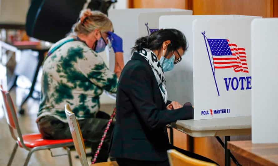 People vote in city hall on the first day of in-person voting in Kenosha, Wisconsin, on 20 October.