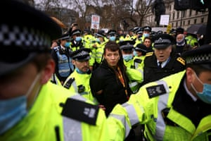 London, UKPolice officers detain an anti-vaccination activist during a demonstration at the Parliament Square