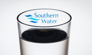 The logo of water company Southern Water seen through a glass of water.