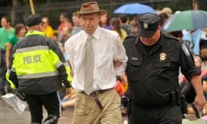 James Hansen is arrested outside the White House for protesting on 27 September 2010.