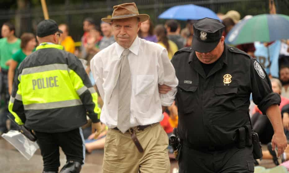 James Hansen is arrested outside the White House for protesting on 27 September 2010.
