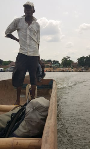 Materials and equipment for the rehabilitation of the water system are transported to Kasongo by boat.