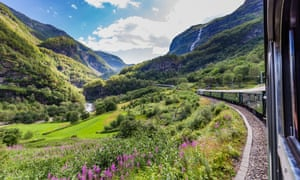 View of mountains and green fields from the Flåm railway, Norway