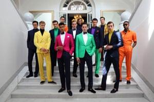 Models wear suits by Ralph Lauren