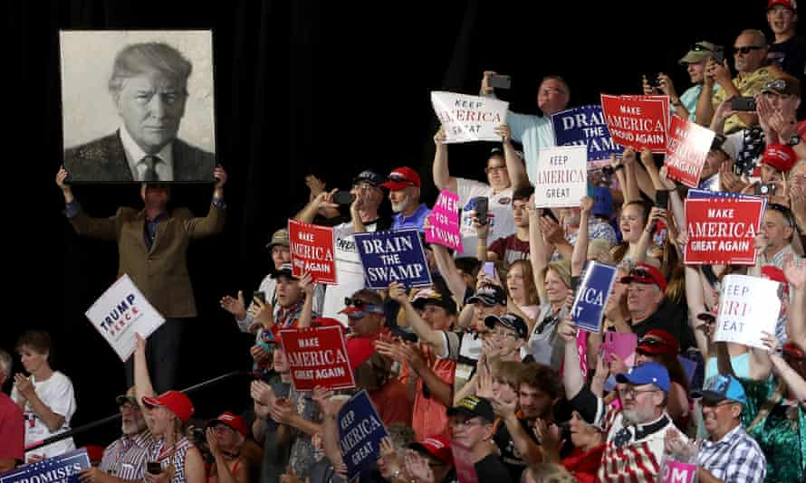 Donald Trump supporters hold signs during a campaign rally at Four Seasons Arena on Thursday in Great Falls, Montana.