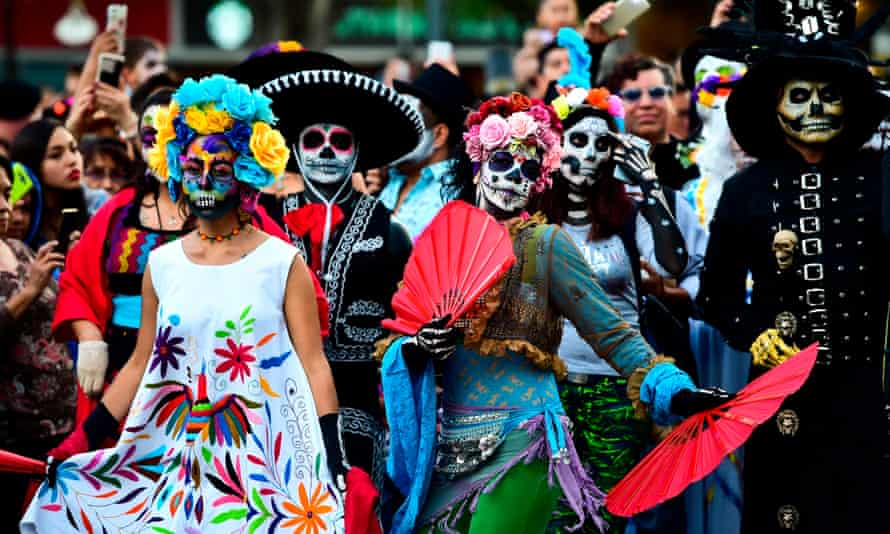 People dressed as 'Catrina' for Day of the Dead parade in Mexico City, Mexico.