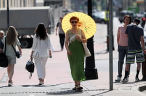 Russia's public health watchdog recommended that employers cut working days by one hour if the temperature indoors reaches 28.5C (83F), by two hours if it reaches 29.5C (85F) and four hours if it reaches 30.5C (87F)