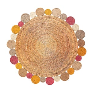 round woven rug with coloured circles on edge, yellow, brown, red grey.