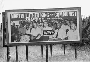 A billboard claiming to identify King at a communist training school stands on the route from Selma to Montgomery, Alabama in 1965. Actually taken at the Highlander Folk School in 1940, it illustrates the depth of antagonism towards King.