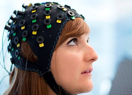 """Shown here on a model, the cap uses infrared light to spot variations in blood flow in different regions of the brain. A computer learns to distinguish the blood flow patterns for """"yes"""" and """"no"""" for each patient."""