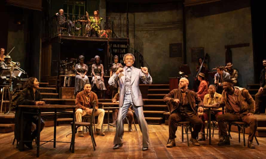 André de Shields, centre, as Hermes, with the company of Hadestown at the Olivier, London.