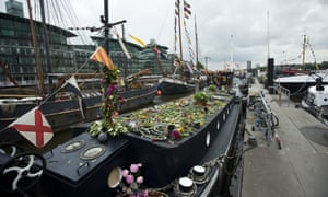Flowers covering the houseboat on the River Thames where Jo Cox lived with her family