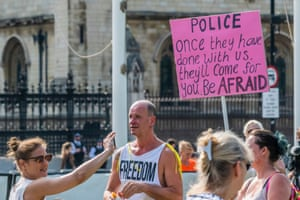 Anti-lockdown campaigners holding a protest at Westminster in London this morning.