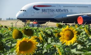 Technicians move a British Airways Airbus A380 airplane stored on the tarmac of Marcel-Dassault airport at Chateauroux, following the outbreak of the coronavirus disease.