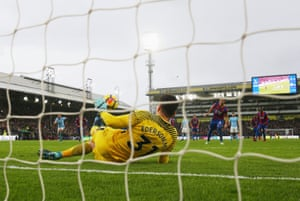 Luka Milivojevic has his penalty saved by Ederson.