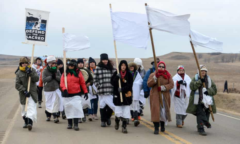Women march to Backwater Bridge during a protest against plans to pass the Dakota Access pipeline near the Standing Rock Indian Reservation, near Cannon Ball, North Dakota, U.S. November 27, 2016. REUTERS/Stephanie Keith