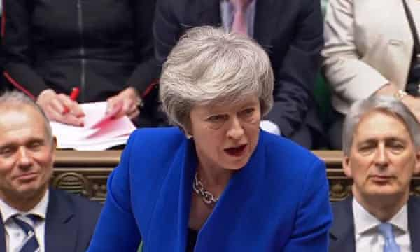 A divided house … Theresa May during PMQs in Westminster.