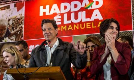 Workers' party candidate Fernando Haddad alongside vice-presidential candidate Manuela Davila.