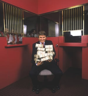 'He wants it, he takes it, he gets it' … Donald Trump holding $1m at his Taj Mahal casino, Atlantic City, 1990