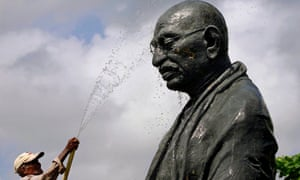A worker cleans the statue of the Mahatma Gandhi in Bhubaneswar, Odisha.