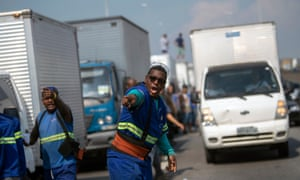 Brazilian truck drivers partially block the Washington Luiz road (BR-040), at Duque de Caxias municipality, during the fifth day of their nationwide strike over rising fuel costs in Rio de Janeiro, Brazil, on Friday.