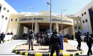Soldiers stand guard outside Al-Hussein Al Salt Hospital in Salt, Jordan on Saturday, March 13, 2021.