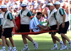 Argentina's captain Diego Simeone is carried off the pitch on a stretche.
