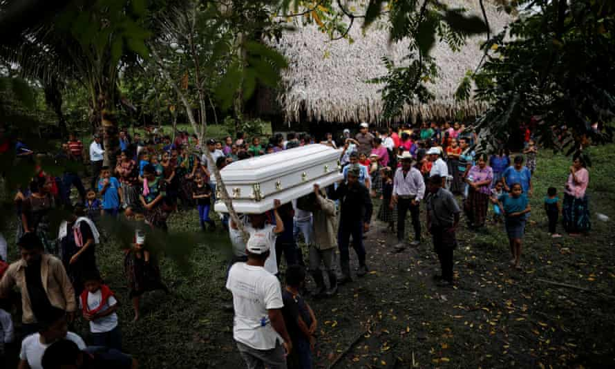 Friends and family carry a coffin with the remains of Jakelin Caal, a seven-year-old girl who handed herself in to US border agents earlier this month and died after developing a high fever while in custody.