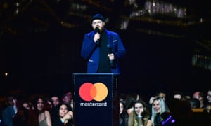Tom Walker accepts the award for best British breakthrough at this year's Brit awards, 20 February 2019.