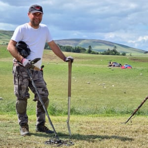 Metal detectorist Mariusz Stepien at the excavation site near Peebles.